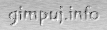 Metaliczny wytłoczony napis